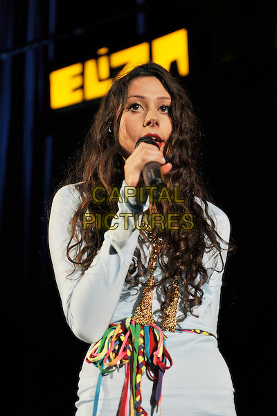 ELIZA DOOLITTLE.Performing live at the Hammersmith Apollo, London, England..November 8th, 2010.stage concert live gig performance music half 3/4 length white blue dress long sleeves singing string belt tassels gold .CAP/MAR.© Martin Harris/Capital Pictures.