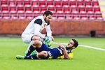 S&ouml;dert&auml;lje 2014-05-31 Fotboll Superettan Syrianska FC - &Auml;ngelholms FF :  <br /> &Auml;ngelholms Othman El Kabir har ont under matchen och tittas till Syrianskas m&aring;lvakt Dejan Garaca <br /> (Foto: Kenta J&ouml;nsson) Nyckelord:  Syrianska SFC S&ouml;dert&auml;lje Fotbollsarena &Auml;ngelholm &Auml;FF skada skadan ont sm&auml;rta injury pain