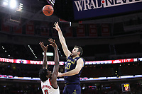 RALEIGH, NC - JANUARY 9: John Mooney #33 of the University of Notre Dame shoots over DJ Funderburk #0 of North Carolina State University during a game between Notre Dame and NC State at PNC Arena on January 9, 2020 in Raleigh, North Carolina.