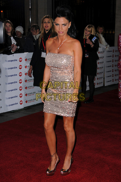 KATIE PRICE (JORDAN) .The Co-operative Variety Club Showbiz Awards, Grosvenor House Hotel, Park Lane, London, England, UK, .14th November 2010. .full length strapless silver sequined sequin dress fake tan tanned shiny platform shoes .CAP/CAS.©Bob Cass/Capital Pictures.