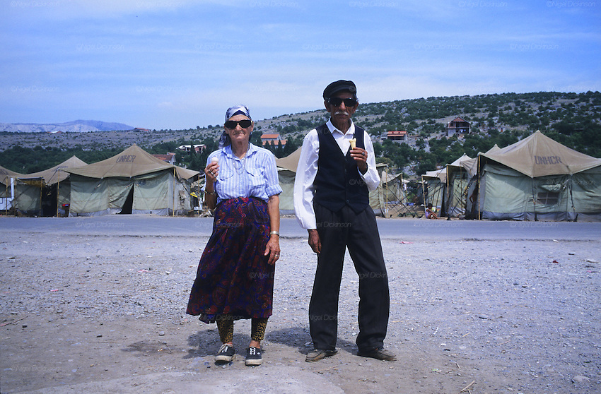 An elderly Roma couple with ice-creams in the infamous Konik refugee camp, where Kosovar Roma refugees were all but forgotten after the war, living on meagre handouts and sheltering in all weathers in a UNHCR tent village long after the war had ended. Podgerica, Montenegro 1999