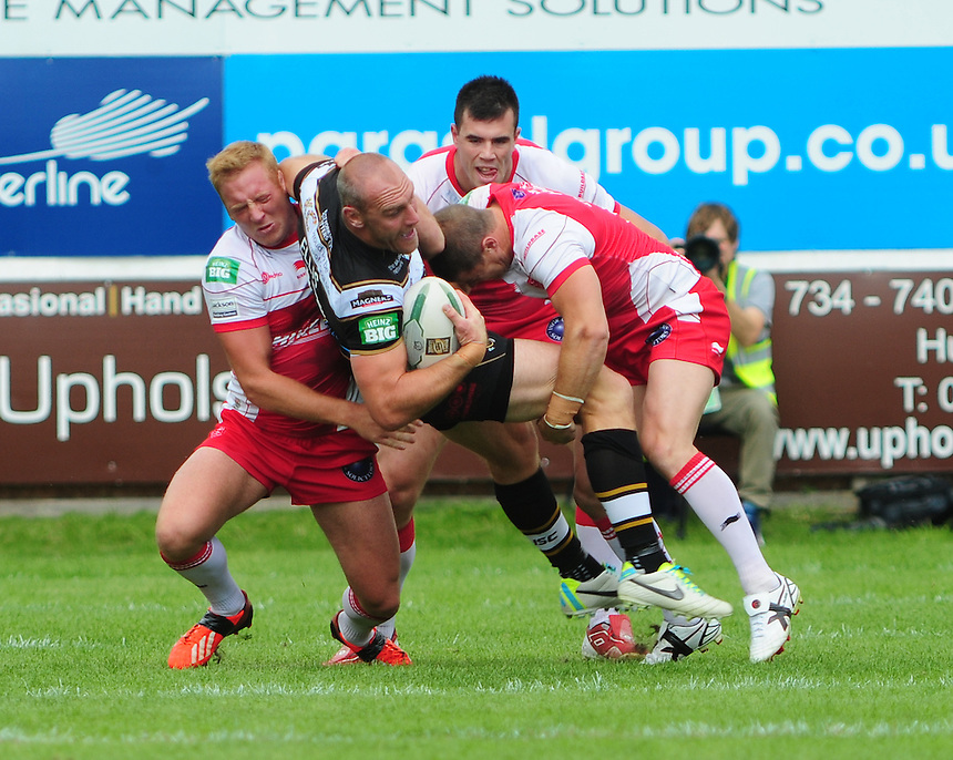 Hull FC's Gareth Ellis is tackled by Hull Kingston Rovers' Sean Gleeson, left, and Hull Kingston Rovers' Travis Burns <br /> <br />  (Photo by Chris Vaughan/CameraSport) <br /> <br /> Rugby League - Super League - Hull Kingston Rovers v Hull FC - Sunday 11th August 2013 - MS3 Craven Park - Hull<br /> <br /> &copy; CameraSport - 43 Linden Ave. Countesthorpe. Leicester. England. LE8 5PG - Tel: +44 (0) 116 277 4147 - admin@camerasport.com - www.camerasport.com