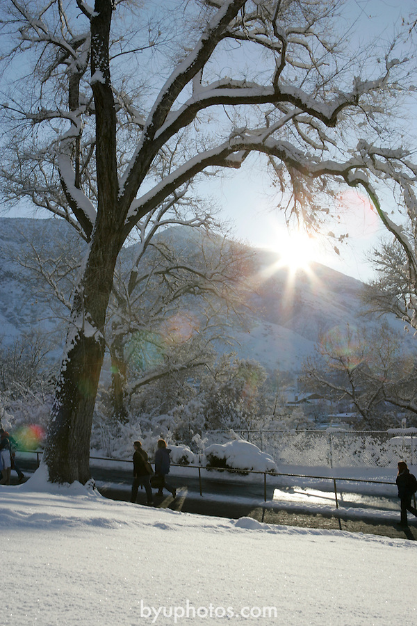 .0501-17 GCS Snow..Photo by Jaren Wilkey/BYU..Copyright BYU Photo 2005.All Rights Reserved.photo@byu.edu  (801)422-7322..1/7/05.Students walking to school, Sunrise, Lower Campus, Maeser Hill. Snow, Winter..