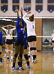 Marymount's Morgan McAlpin and Cassidie Watson start a college volleyball game against St. Mary's, in Lexington Park, MD, on Wednesday, Oct. 29, 2014. Marymount won 3-2 to go 24-9 on the season.<br /> Photo by Cathleen Allison