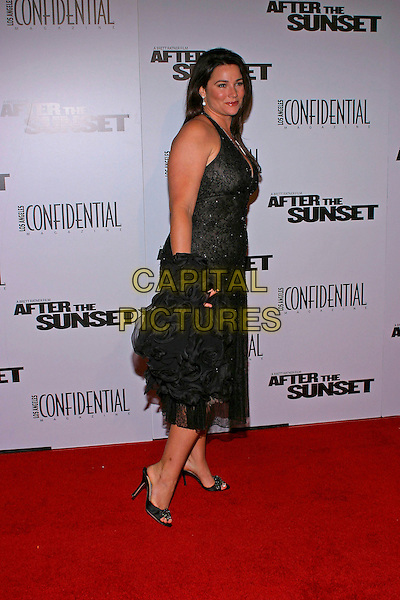 "KEELY SHAYE SMITH.At the US premiere of ""After the Sunset"" held at Grauman's Chinese Theatre,  Hollywood, California, USA, .4th November 2004  .full length Keeley Shaye-Smith black halterneck dress.**UK SALES ONLY**.Ref: ADM.www.capitalpictures.com.sales@capitalpictures.com.©Capital Pictures."
