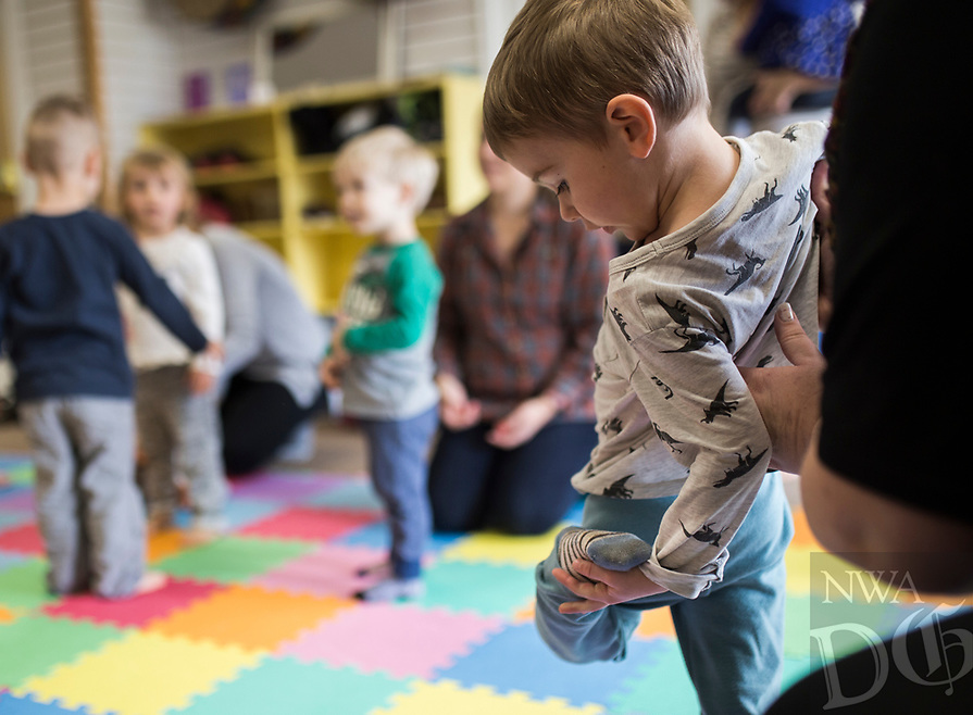 NWA Democrat-Gazette/CHARLIE KAIJO Alexander Berger, 2, of Fayetteville practices a yoga pose during a Splatter & Stretch class NWA, Thursday, January 10, 2019 at Jubilee Music in Rogers. <br />