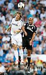 Real Madrid's  Luka Modric against Granada's Guilherme Siqueira during La Liga match. September 02, 2012. (ALTERPHOTOS/Alvaro Hernandez).