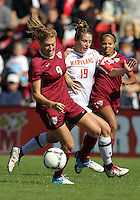 COLLEGE PARK, MD - OCTOBER 21, 2012:  Becky Kaplan (19) of the University of Maryland chases Kassey Kallman (9) of Florida State during an ACC women's match at Ludwig Field in College Park, MD. on October 21. Florida won 1-0.