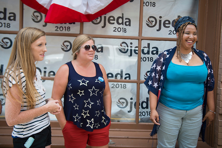 UNITED STATES - July 5: Richard Ojeda's Field Director Charkera Ervin, 32, right, chats with volunteers outside Ojeda's campaign headquarters in Logan, West Virginia Thursday July 5, 2018. Ojeda is a first-term lawmaker from southern West Virginia running to represent the state's 3rd Congressional District as a Democrat. (Photo By Sarah Silbiger/CQ Roll Call)