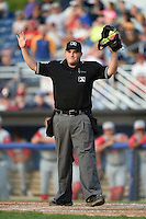 Umpire Dave Albertson calls time during a game between the Lowell Spinners and Batavia Muckdogs on July 18, 2014 at Dwyer Stadium in Batavia, New York.  Lowell defeated Batavia 11-2.  (Mike Janes/Four Seam Images)