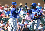 Los Angeles Dodgers&rsquo; Justin Turner and Howie Kendrick score during a spring training game in Scottsdale, Ariz., on Friday, March 18, 2016. <br />Photo by Cathleen Allison