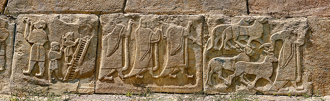 Pictures & Images Hittite relief sculpted orthostat panels of the Sphinx Gate. Left panel depicts jugglers next panel depicts a procession following (right) a man leading goats to be sacrificed.  Alaca Hoyuk (Alacahoyuk) Hittite archaeological site  Alaca, Çorum Province, Turkey, Also known as Alacahüyük, Aladja-Hoyuk, Euyuk, or Evuk