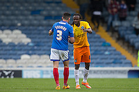 Marcus Bean of Wycombe Wanderers shakes hands with Enda Stevens of Portsmouth at the final whistle during the Sky Bet League 2 match between Portsmouth and Wycombe Wanderers at Fratton Park, Portsmouth, England on 23 April 2016. Photo by Andy Rowland.
