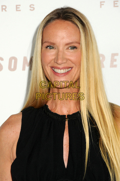 "KELLY LYNCH.""Somewhere"" Los Angeles Premiere held at Arclight Cinemas, Hollywood, California, USA, .7th December 2010..portrait headshot smiling black sleeveless cut out .CAP/ADM/BP.©Byron Purvis/AdMedia/Capital Pictures."
