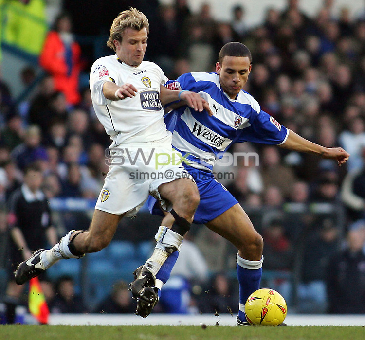 Pix, Shaun Flannery/SWpix. Coca-Cola League Championship. Leeds United v Reading, 12.2.2005...COPYRIGHT PICTURE>>SIMON WILKINSON>>01943 - 608782>>..Leeds Michael Gray battles with Reading's Dean Morgan.