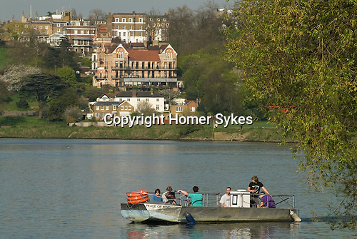 Hammertons Ferry across River Thames at Richmond. It crossrs from near Ham House in Ham to near Marble Hill House in Twickenham London