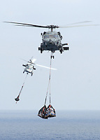 "070809-N-7981E-477 PACIFIC OCEAN (August 9, 2007)- An SH-60F and an HH-60H Seahawk from Helicopter Anti-submarine Squadron (HS) 2 ""Golden Falcons"" carry supplies to the Nimitz-class aircraft carrier USS Abraham Lincoln during a Vertical Replenishment (VERTREP) with the Modular Cargo Deliver System Ship SS Cape Gibson (T-AK-5051). Lincoln and embarked Carrier Air Wing (CVW) Two are underway off the coast of Southern California conducting Tailored Ship's Training Availability. U.S. Navy photo by Mass Communication Specialist 3rd Class James R. Evans"