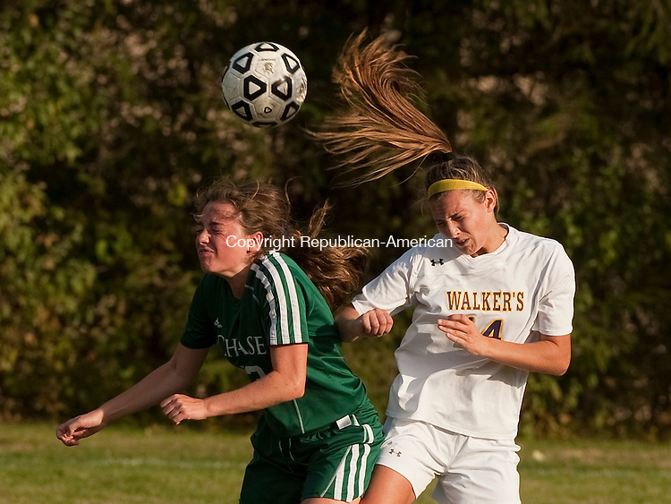 WATERBURY, CT--- -102115JS16---Chase's Maggie Atkins (13) and Ethel Walker's Madison Lamagna (14) both go up for the  ball during their game Wednesday at Chase Collegiate School in Waterbury. <br /> Jim Shannon Republican-American