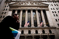 People walk in front New York Stock Exchange while Verizon Management discusses Q4 2011 results in New York, United States. 23/01/2012.  Photo by Eduardo Munoz Alvarez / VIEWpress.
