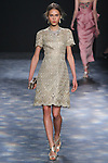 Model Line walks runway in a gold ornate laser-cut and threadwork brocade cocktail with cap sleeves, from the Marchesa Fall 2016 collection by Georgina Chapman and Keren Craig, presented at NYFW: The Shows Fall 2016, during New York Fashion Week Fall 2016.