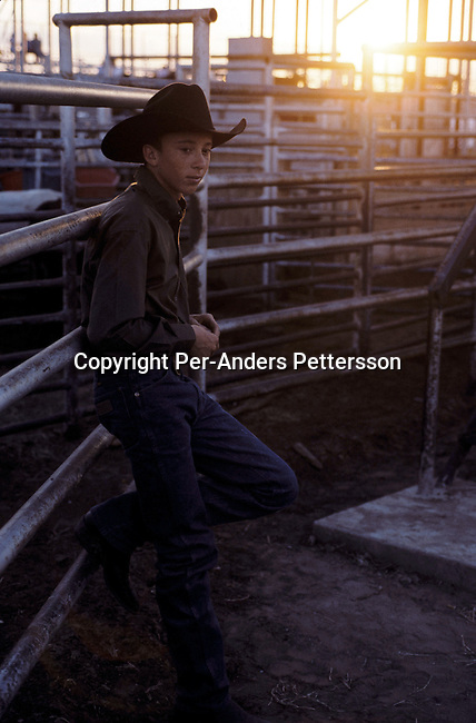 An unidentified boy dressed in cowboy clothes on July 13, 1998 in Brownsville, Texas, USA. They are attending a yearly rodeo held at a local stadium. Rodeo is on of the most popular pastimes in this area. .(Photo: Per-Anders Pettersson/Getty Images).