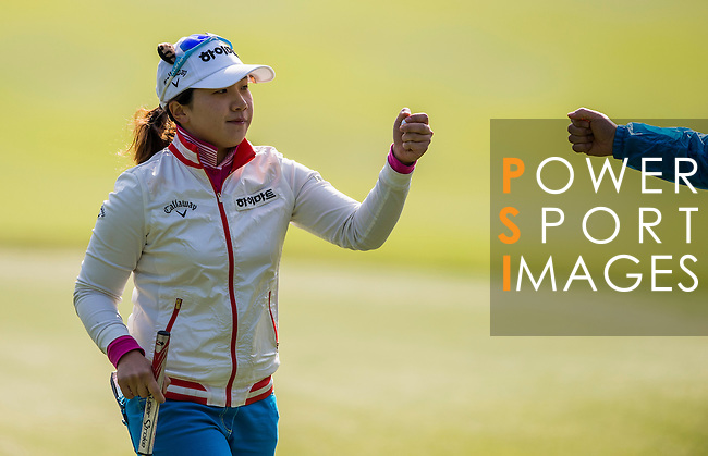 Ji-Hyun Kim of Korea reacts during the Hyundai China Ladies Open 2014 at World Cup Course in Mission Hills Shenzhen on December 13 2014, in Shenzhen, China. Photo by Li Man Yuen / Power Sport Images
