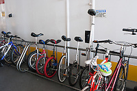 Governor's  Island, NY -  4 September 2010- Bicycles share the rack with unicycles on the free ferry to Governor's Island.