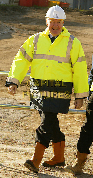JOHN REID (HOME SECRETARY) .Helps with the building of a new prison block at High Down Prison, UK..November 3rd, 2006.Ref: FEE.full length yellow fluorescent jacket hard hat construction.www.capitalpictures.com.sales@capitalpictures.com.©FEE/Capital Pictures