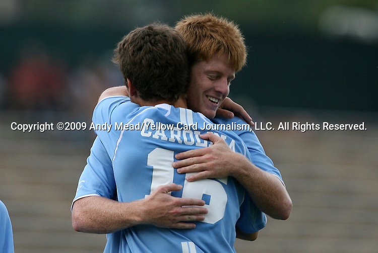 06 September 2009: UNC's Enzo Martinez (16) celebrates his goal with Dustin McCarty. The University of North Carolina Tar Heels defeated the Evansville University Purple Aces 4-0 at Fetzer Field in Chapel Hill, North Carolina in an NCAA Division I Men's college soccer game.