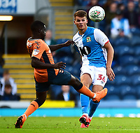 Blackburn Rovers' Matthew Platt competes with Oldham Athletic's Christopher Missilou<br /> <br /> Photographer Richard Martin-Roberts/CameraSport<br /> <br /> The Carabao Cup First Round - Tuesday 13th August 2019 - Blackburn Rovers v Oldham Athletic - Ewood Park - Blackburn<br />  <br /> World Copyright © 2019 CameraSport. All rights reserved. 43 Linden Ave. Countesthorpe. Leicester. England. LE8 5PG - Tel: +44 (0) 116 277 4147 - admin@camerasport.com - www.camerasport.com