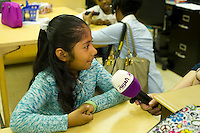 A student is interviewed by Al Arabiya TV.  First and second graders learn Arabic at P.S. 368-Hamilton Heights School in Harlem in New York on Wednesday, May 23, 2012. The program is the first at the K-5 school level in New York City Public Schools.  © Frances M. Roberts)