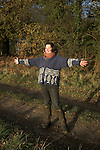 Model released woman enjoying winter sun in the countryside