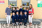 Principal Geraldine Shanahan and class teacher Mary V O'leary with their new junior infants front l-r Mia Kate Horgan, Megan Looney, Makayla O'Leary and Olivia O'Connor back l-r Ryan Carmody, Cillian Cronin, Thade Swanwick, Ben Murphy and Max Dorrill on their first day of school at Gneeveguilla NS last Tuesday.