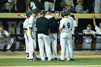 Wake Forest Demon Deacons head coach Tom Walter (16) gives instructions to his team in the bottom of the ninth inning against the West Virginia Mountaineers in Game Four of the Winston-Salem Regional in the 2017 College World Series at David F. Couch Ballpark on June 3, 2017 in Winston-Salem, North Carolina.  The Demon Deacons walked-off the Mountaineers 4-3.  (Brian Westerholt/Four Seam Images)