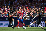 Antoine Griezmann (c) of Atletico de Madrid fights for the ball with Clement Nicolas Laurent Lenglet and Lionel Jules Carole of Sevilla FC during the La Liga 2017-18 match between Atletico de Madrid and Sevilla FC at the Wanda Metropolitano on 23 September 2017 in Wanda Metropolitano, Madrid, Spain. Photo by Diego Gonzalez / Power Sport Images