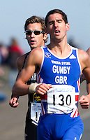 25 MAR 2012 - LOUGHBOROUGH, GBR - Mark Buckingham (Holmfirth Harriers) (left) runs just behind Matt Gunby (PACTRAC)  during the men's 2012 British Elite Duathlon Championships at Prestwold Hall Airfield in Prestwold near Loughborough, Great Britain (PHOTO (C) 2012 NIGEL FARROW)