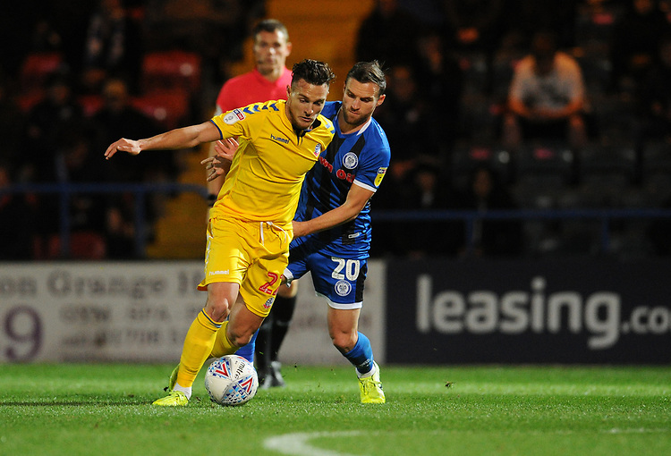 Bolton Wanderers' Dennis Politic under pressure from Rochdale's Jimmy Ryan<br /> <br /> Photographer Kevin Barnes/CameraSport<br /> <br /> EFL Leasing.com Trophy - Northern Section - Group F - Rochdale v Bolton Wanderers - Tuesday 1st October 2019  - University of Bolton Stadium - Bolton<br />  <br /> World Copyright © 2018 CameraSport. All rights reserved. 43 Linden Ave. Countesthorpe. Leicester. England. LE8 5PG - Tel: +44 (0) 116 277 4147 - admin@camerasport.com - www.camerasport.com