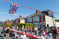 Pictured: A flag with Meghan Markle and Prince Harry waves amongst flags at a street party in Cardiff. Saturday 19 May 2018<br /> Re: Prince Harry and Meghan Markle Royal Wedding Street Party at Avondale Crescent in Cardiff, Wales, UK.
