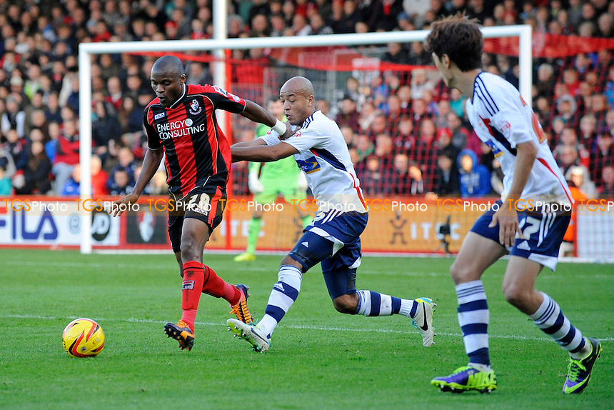 Tokelo Rantie of AFC Bournemouth holds off Alex John-Baptiste of Bolton Wanderers - AFC Bournemouth vs Bolton Wanderers - Sky Bet Championship Football at the Goldsands Stadium, Bournemouth, Dorset - 02/11/13 - MANDATORY CREDIT: Denis Murphy/TGSPHOTO - Self billing applies where appropriate - 0845 094 6026 - contact@tgsphoto.co.uk - NO UNPAID USE