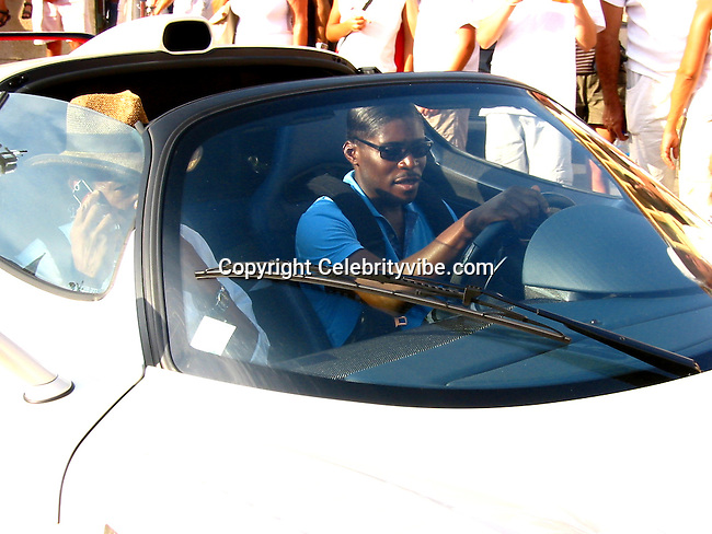 """**EXCLUSIVE** African Playboy, Your Royal Highness, Teodoro Nguema Obiang Mangue, nicknamed Teodorin, Theodore, the son of the President of Equatorial Guinea, who is expected to take over the Presidency in September 2006, and Singer/Actress Eve's three year boyfriend, getting off his Yacht """"Thunder Gulch"""" going to his awaiting Limited Edition Maserati at the Port of St Tropez with new Model girlfriend from Senegal, Eve is nowhere to be found. .St Tropez, France.Saturday, July 22, 2006.Photo By Celebrityvibe.com.To license this image please call (212) 410 5354; or.Email: celebrityvibe@gmail.com ;.Website: www.celebrityvibe.com ..Celebrityvibe.com.www.celebrityvibe.com."""