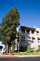 Redwood trees right next to the San Mateo Public Library provide natural shading and heat reduction. The building integrates significant green building practices and achieved LEED Silver certification. Green features include extensive daylighting, efficient underfloor air supply, venting windows, low VOC materials, native plant landscaping, and much more. San Mateo, California, USA