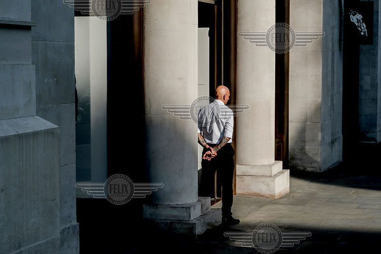 A security guard outside a shop on Regent Street.