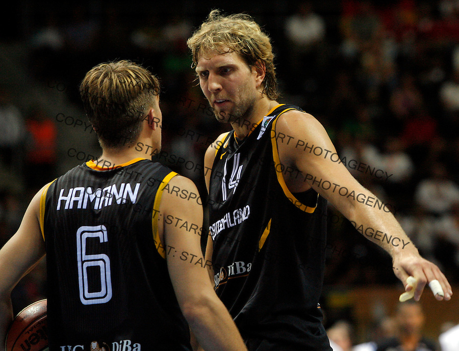 Germany`s Dirk Nowitzki argues with his teammate Hamann Steffen during round 1, Group B, basketball game between France and Germany in Lithuania, Siauliai, Siauliu arena, Eurobasket 2011, Friday, September 2, 2011. (photo: Pedja Milosavljevic/STARSPORT)
