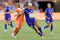 Lianne Sanderson (10) of the Orlando Pride and Andressa (17) of the Houston Dash battle for control of the ball on Friday, May 20, 2016 at BBVA Compass Stadium in Houston Texas. The Orlando Pride defeated the Houston Dash 1-0.