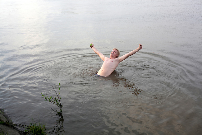 A foreigner goofs off in the Saigon River outside Ho Chi Minh City, Vietnam. Sept. 1, 2011.