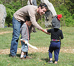 "A father mediates between two young ""warriors"" at the Beltane Earth Fest 2012, held on the grounds of The Center for Symbolic Studies at Stone Mountain Farm, New Paltz (near the Village of Tillson), NY on Saturday, April 28, 2012. Photograph Copyright Jim Peppler/2012."