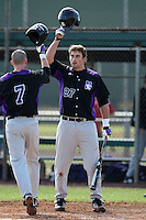 February 27, 2010:  First Baseman Chris Lashmet of the Northeastern Wildcats greets Chad Noble (7) after a home run during the Big East/Big 10 Challenge at Raymond Naimoli Complex in St. Petersburg, FL.  Photo By Mike Janes/Four Seam Images