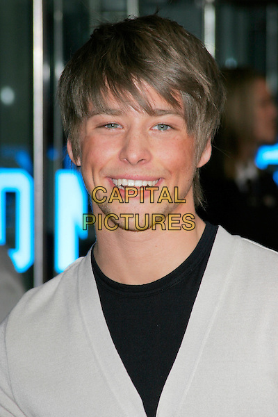 "MITCH HEWER.UK Premiere of ""Hannah Montana: The Movie"" at the Odeon Leicester Square, London, England. .April 23rd 2009 .headshot portrait black grey gray stubble facial hair .CAP/AH.©Adam Houghton/Capital Pictures."