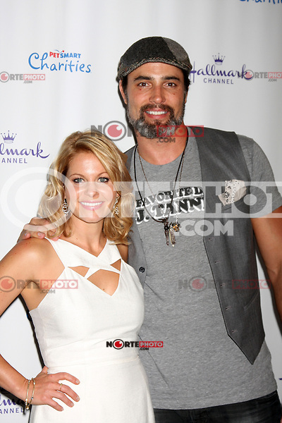 LOS ANGELES, CA- SEPTEMBER 6: Candance Cameron Bure and Victor Webster at the Hallmark Channel's &quot;Puppy Love'&quot; Private Reception at La Piazza at The Grove in Los Angels, California. &copy;&nbsp;mpi27/MediaPunch Inc. /NortePhoto.com<br />