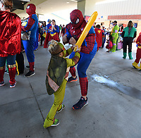 "NWA Democrat-Gazette/J.T. WAMPLER Kai Finks, 3, dressed as the Teenage Mutant Ninja Turtle Michelangelo, duels with his dad Jacob Fincus of Fayetteville dressed as Spiderman Sunday May 7, 2017 during the ""A League of Their Own"" reunion softball game at Arvest Ballpark in Springdale. The event concluded the Bentonville Film Festival. Over a thousand people dressed in costume, attempting set a world record for most people dressed as super heroes. They fell over 500 people short."